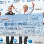 Roger Daltrey, lead singer of The Who accepting a check from Fremont Street Experience President Jeff Victor for Teen Cancer America a charity inspired by Daltrey and Pete Townshend Monday, Aug. 12 at Fremont Street Experience in Downtown Las Vegas.